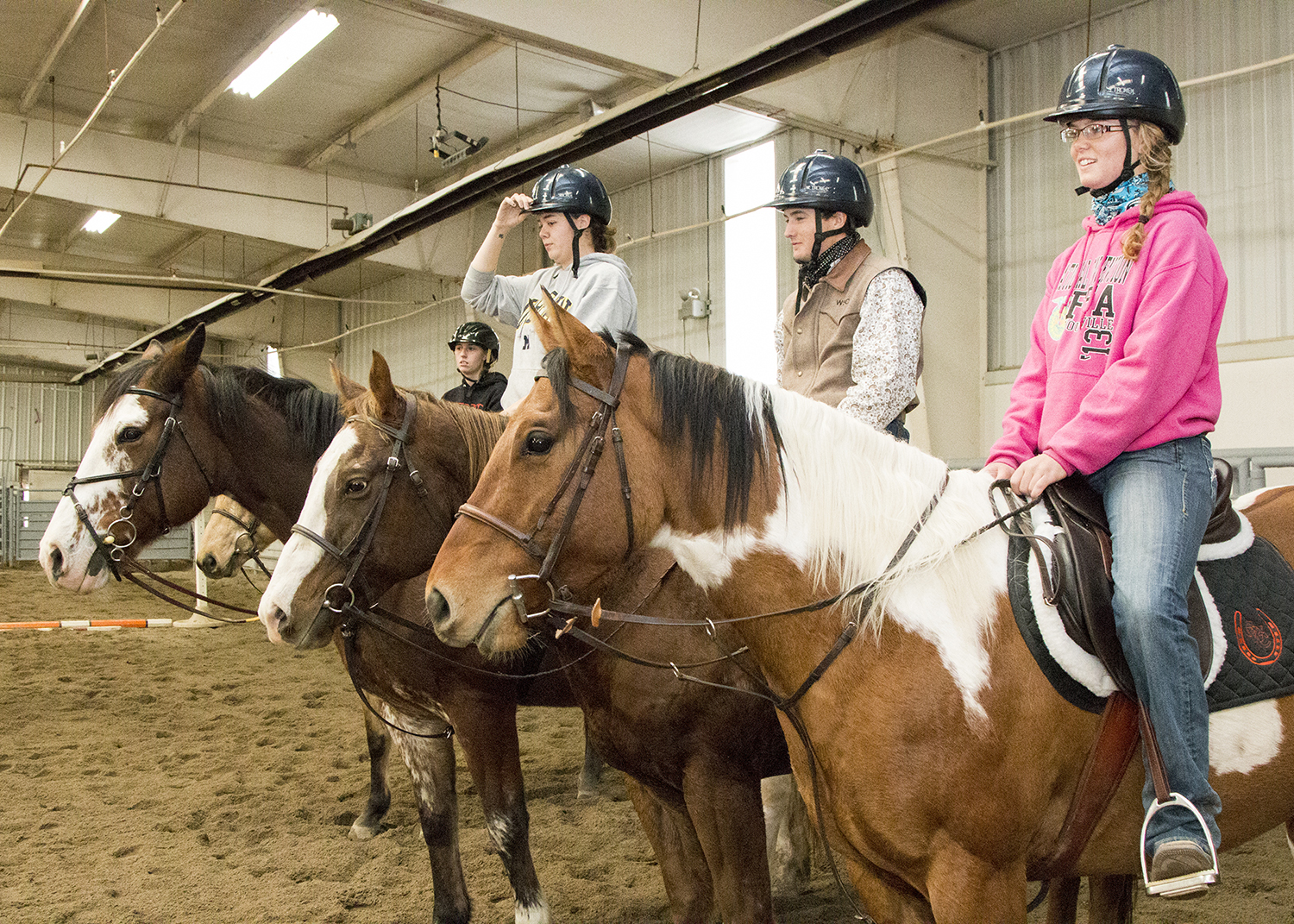 Students on their horses in the equine center