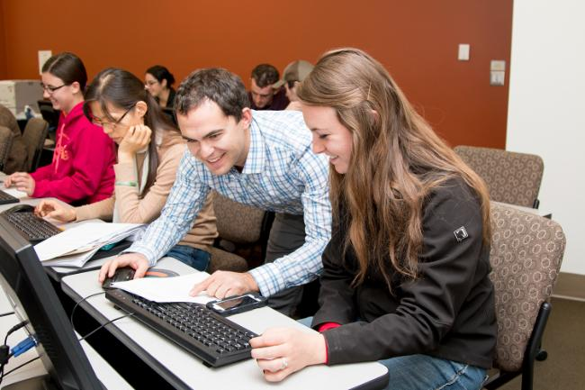 Students look at a computer screen in mathematica class