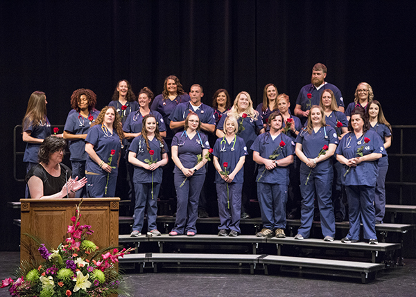 CWC nursing student on stage for pinning ceremony