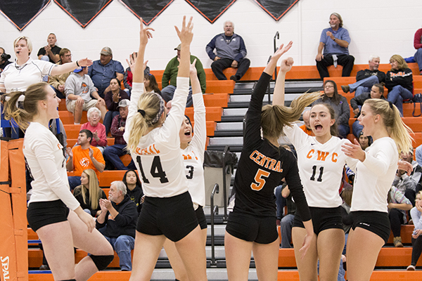 CWC volleyball players celebrating a point