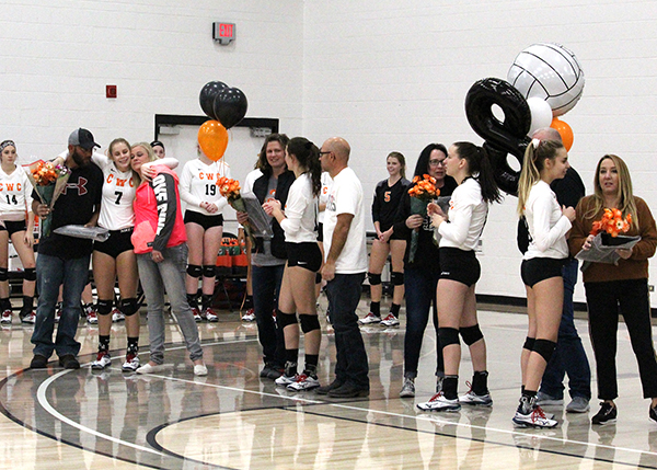 CWC sophomore volleyball players on the court with their loved ones.
