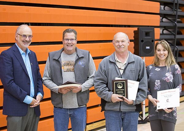 Employees recognized for 15 years of service.