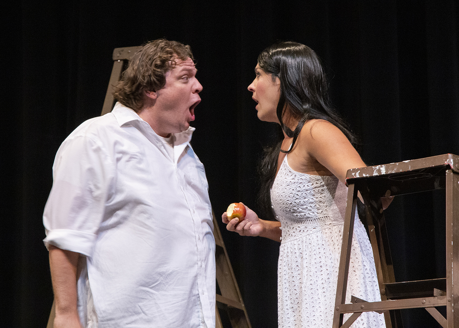 An actor playing Adam and an actor playing Eve on stage
