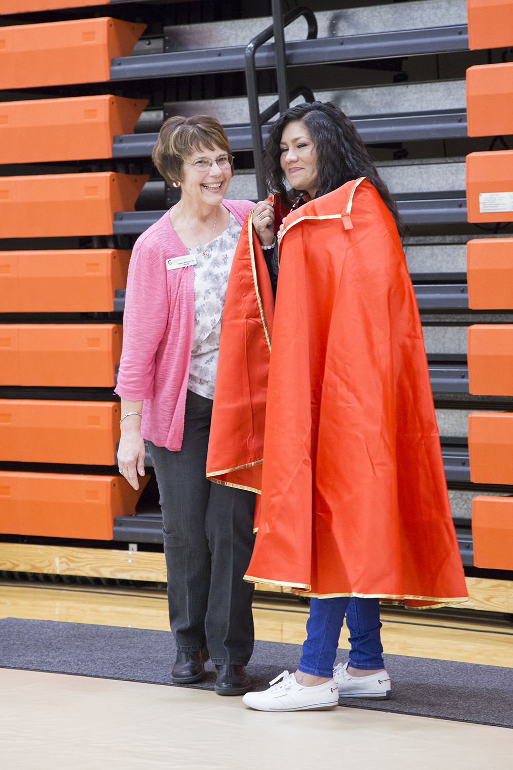 The nursing department presents Fiona with a superman cape for all her help in the simulation lab.