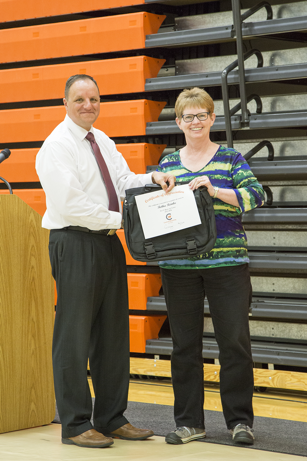 Retha Reinke receives an award for her years of service.