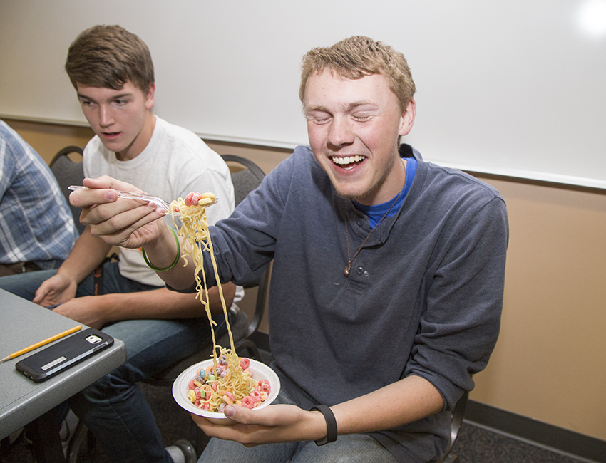 CWC student judges a ramen noodle dish with fruit loops