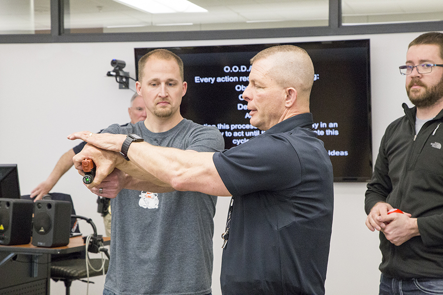 CWC employee learns how to carefully secure a gun from an active shooter