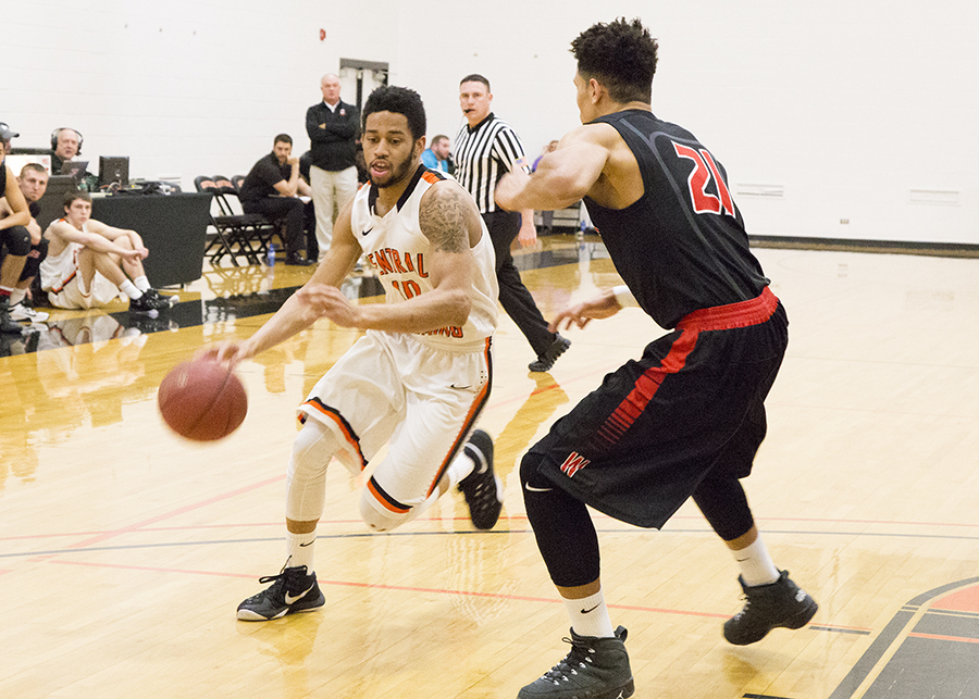 CWC basketball player dribbles ball past Western Wyoming Community College player