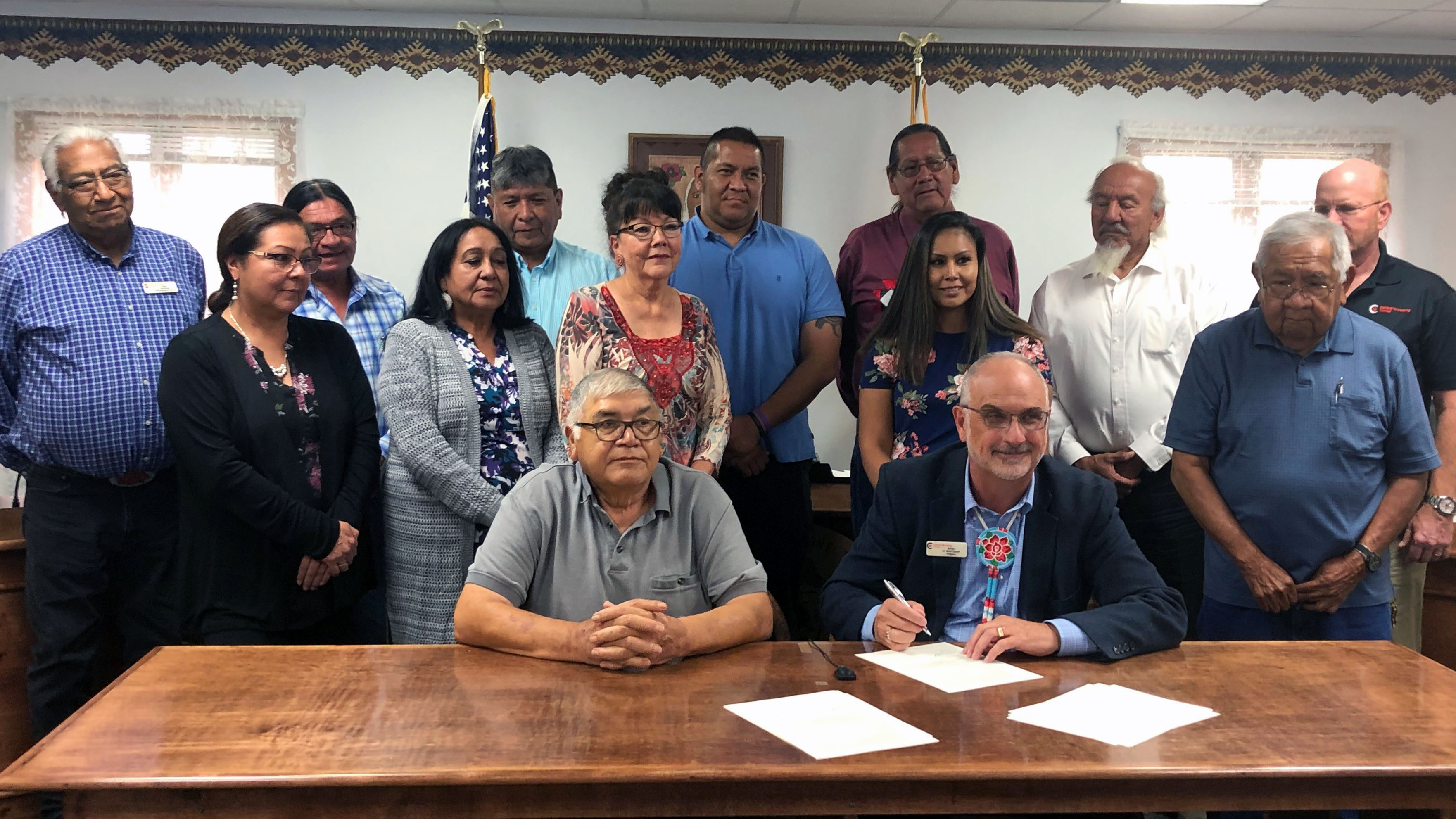 Eastern Shoshone Tribal Council members and Dr. Brad Tyndall signing MOU at tribal council chambers.