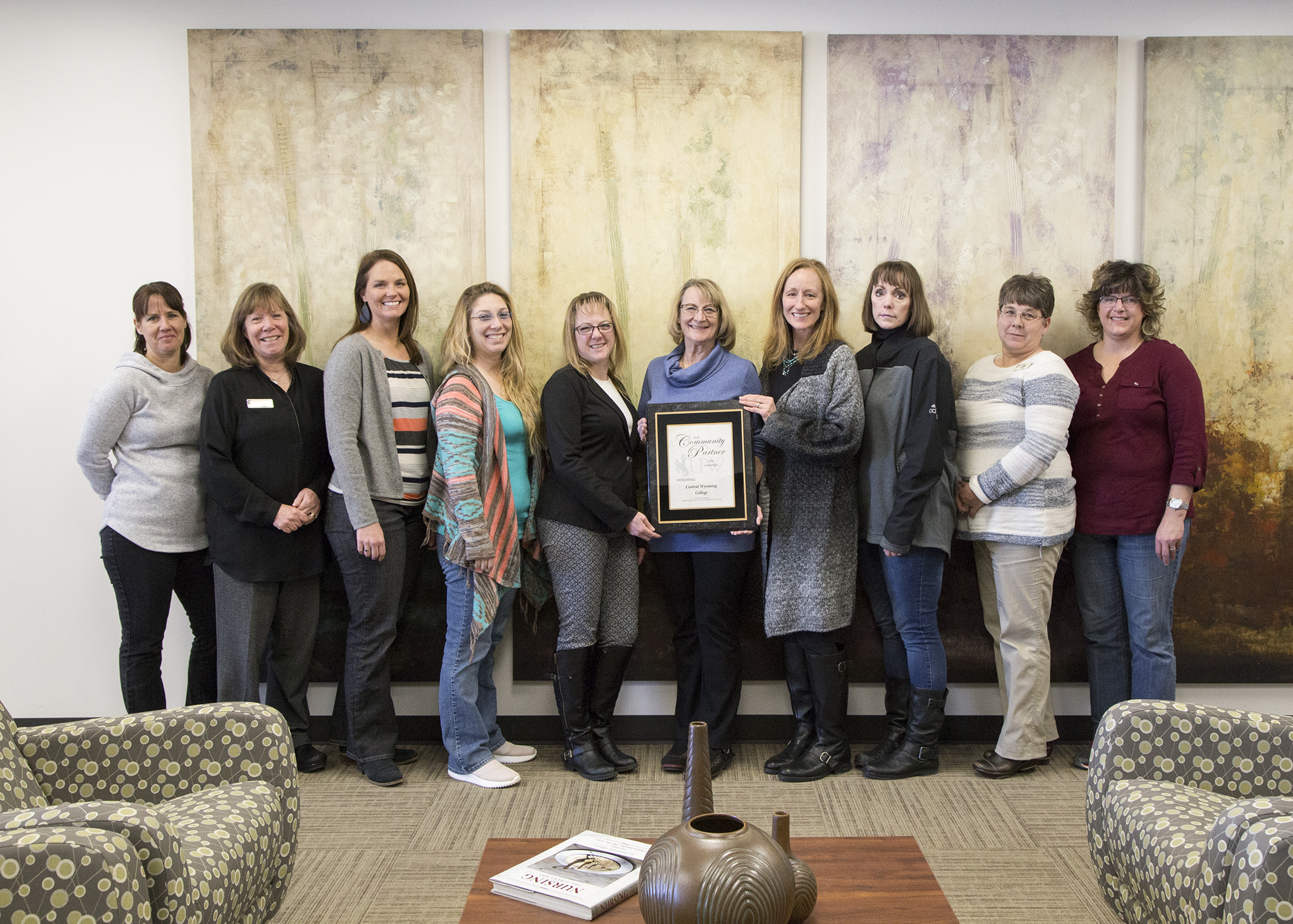 The CWC nursing staff stands holding an award from UW