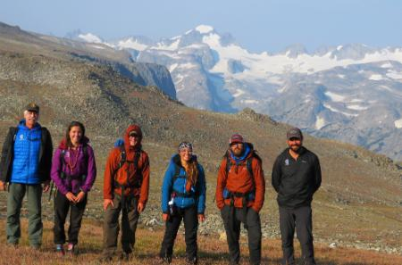 student standing in the Wind River range where Fourt once stood with his pack team