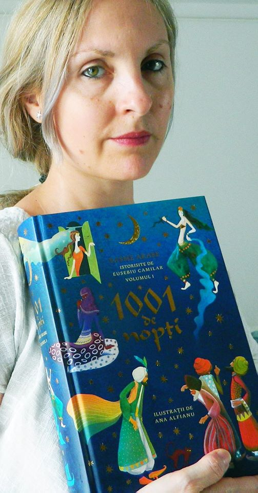 photo of CWC alumna Ana Alfianu holding her published book of illustrations