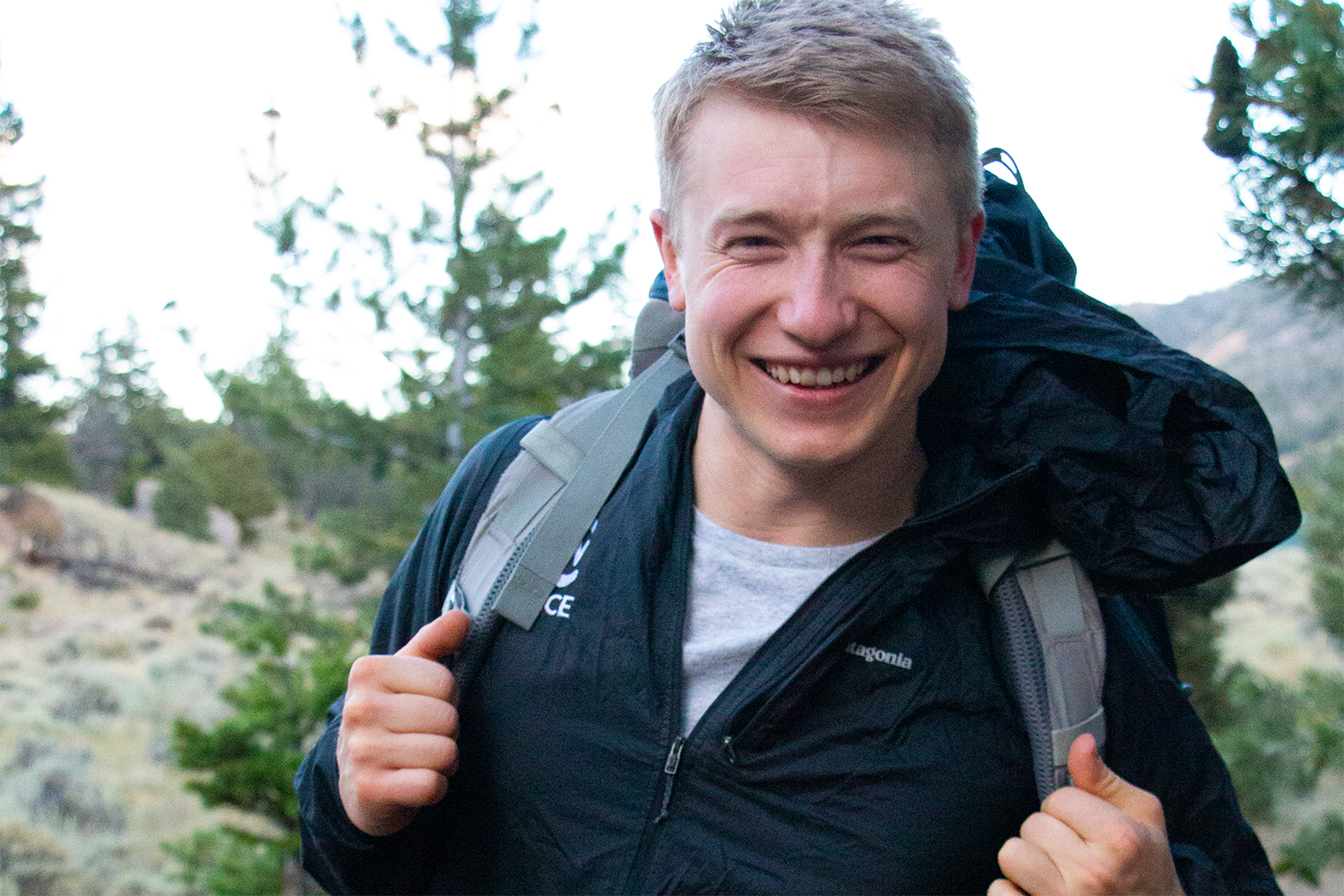 photos of CWC alumnus Marten Bauer wearing a backpack in the woods