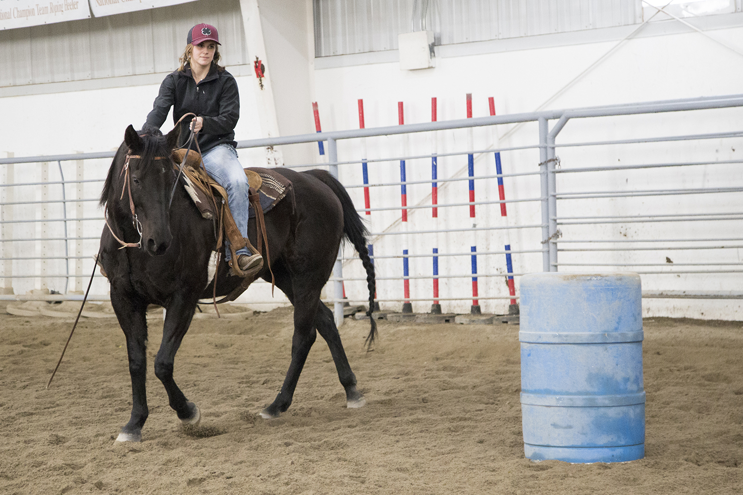 CWC student rides her horse around a barrel for a barrel clinic class