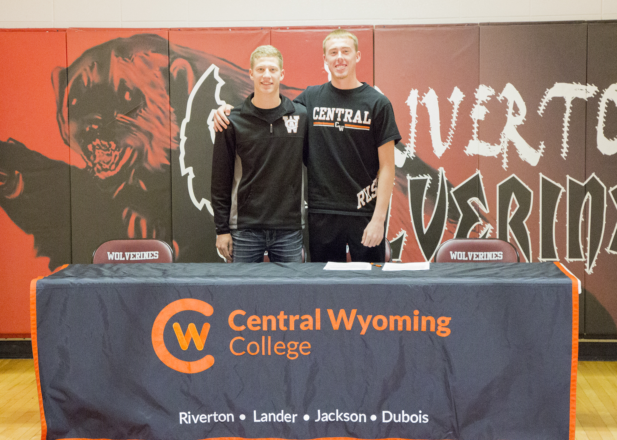 photo of high school men basketball players signing a letter of intent with Central Wyoming College